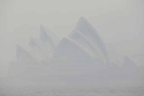 Thick smoke from wildfires shroud the Opera House in Sydney, Australia.