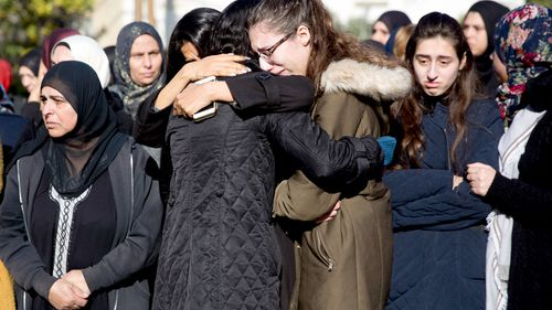 Women cry during the funeral for Aya Maasarwe.