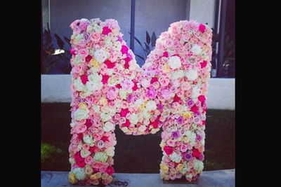 """Miley's friends surprised her with a massive """"M"""" made out of flowers."""