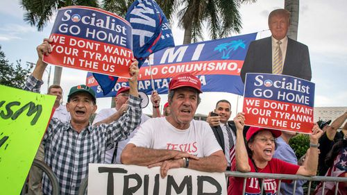 Trump supporters protest the debate.