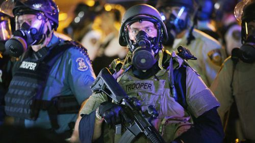 State Troopers move in on the rioters. (Getty Images)