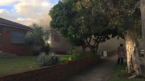 A fire has burnt through the back of a house on Moorefields Road. (9NEWS)