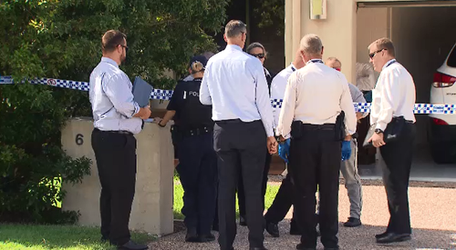 Police are scouring a Browns Plains home after a man received critical head injuries during a fight overnight.