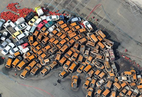 An aerial picture shows burnt cars spread at a yard in Nishinomiya, Hyogo Prefecture, western Japan