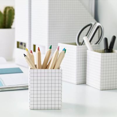 "<p>Keep those pens and pencils in sharp order with a neat-looking pencil holder.</p> <p><a href=""http://www.ikea.com/au/en/catalog/products/00374457/"" target=""_blank"">IKEA Hejsan Pen Cup, set of three, $4.99.</a></p>"