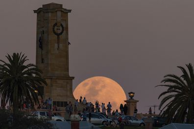 Crowds look on as the Supermoon rises behind the Fremantle War Memorial at Monument Hill on November 14, 2016.