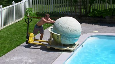 Watch the world's biggest bath bomb be thrown into a swimming pool