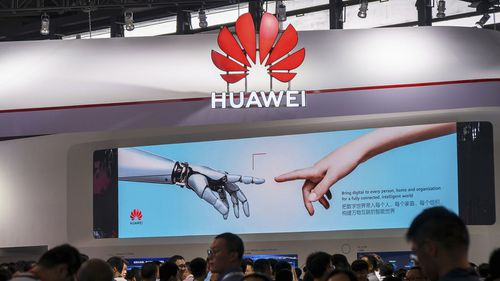 In this June 26, 2019, photo, visitors tour the Huawei pavilion at the Mobile World Congress in Shanghai, China.