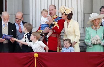 Britain's Prince William and Kate, the Duchess of Cambridge with their Prince George, center left, Princess Charlotte, center right, and Prince Louis, top center, attend the annual Trooping the Colour Ceremony in London, Saturday, June 8, 2019. (AP Photo/Frank Augstein)