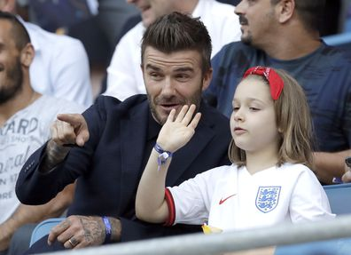 David Beckham with his daughter Harper at the Women's World Cup quarterfinal soccer match between Norway and England.