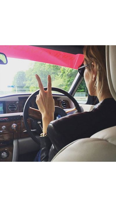 <p>Blogger Elena Perminova gets behind the wheel.</p>