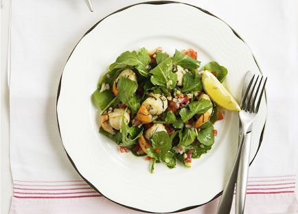 Pan-seared scallops with sage and rocket and Israeli salad