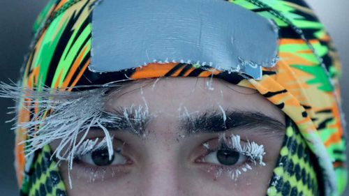 University of Minnesota student Daniel Dylla was frosted in the morning cold while pausing from a jog along the Mississippi River in Minneapolis.