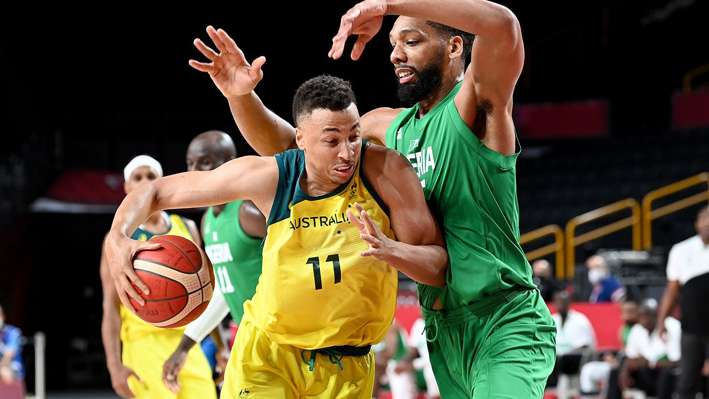 Dante Exum of Australia takes on the defence of Jahlil Okafor of Nigeria during the preliminary rounds of the Men's Basketball match between Australia and Nigeria on day two of the Tokyo 2020 Olympic Games at Saitama Super Arena on July 25, 2021 in Saitama, Japan. (Photo by Bradley Kanaris/Getty Images)
