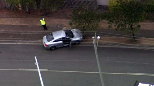 The teen ran over a Queensland police officer in Booval before crashing into a tree.