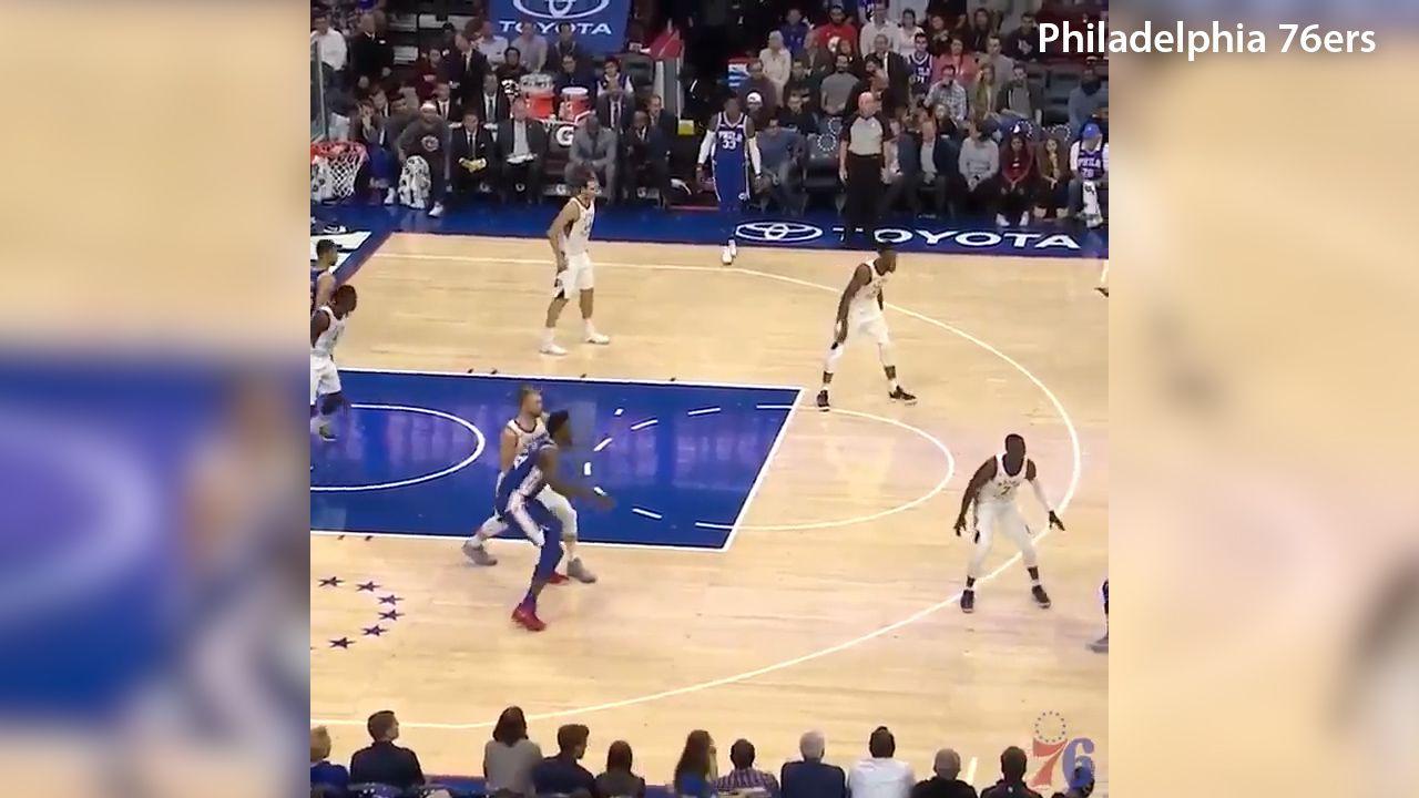 Simmons scores triple double