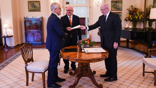 The bill being presented to Sir Peter Cosgrove (AAP)