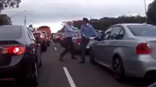 The two men could be seen swinging fists at each other in Terrey Hills yesterday afternoon (Dash Cam Owners Australia)