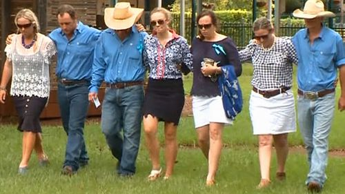 Dolly's friends and family, including dad Tick, her mum Kate and sister Meg. (9NEWS)