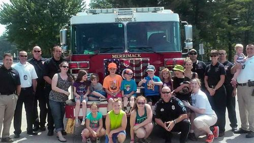 Police and firefighters surprise young boy 'stood up' by playmates