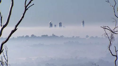 The skyscrapers peek above the smoke. Picture: 9NEWS