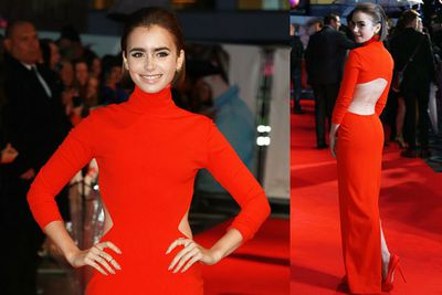 Wowser! Lily Collins looks incredible in that backless red gown.