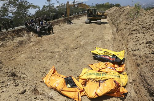 A mass grave is being dug for the victims.