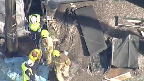 The moment the driver walked from the crumpled front cab of the truck. (9NEWS)