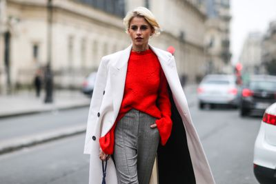 Street style at Milan Fashion Week and it's all about that pop of red.