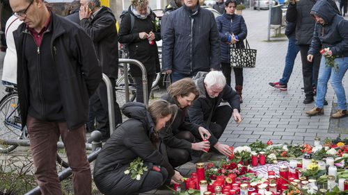 People put flowers and candles near the Midnight Shiha Bar for the victims of the recent shooting on February 21, 2020 in Hanau, Germany. On the night of February 19 a local man named Tobias Rathjen shot dead nine people in Hanau before likely turning the gun on his mother and himself. Police suspect a right-wing motive to the crime.
