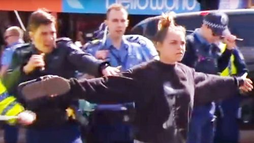 Hayley Garlett said she didn't stop to think when she stepped in front of the police line. (9News)