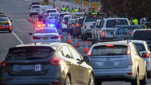 Queues at the border as NSW Police stop traffic from Victoria to check their permits earlier this month.