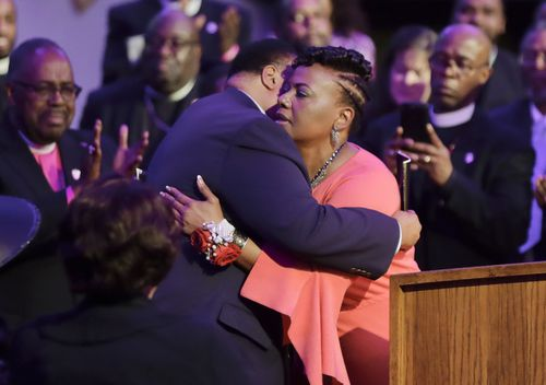 Martin Luther King III hugs his sister, the Reverend Bernice King. (AAP)