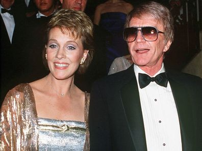 English singer and actress Julie Andrews with her husband Blake Edwards at a British Olympic Association gala, 18th April 1984.  (Photo by Kypros/Getty Images)
