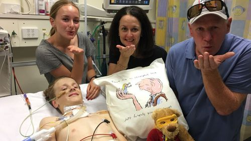 The Mould family are staying positive as they remain by Louie's bedside following the freak accident. (Supplied)
