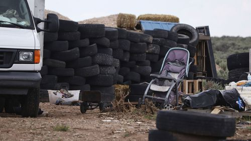 Three women believed to be the mothers of 11 children found hungry and living in a filthy makeshift compound in rural northern New Mexico have been arrested.