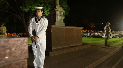 Able Seaman Toby Straatman rests on arms during the Anzac Day Dawn Service at the Cenotaph in Darwin. (AAP)