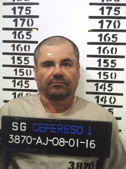 """In this Jan. 8, 2016 file photo released by Mexico's federal government, Mexico's drug lord Joaquin """"El Chapo"""" Guzman stands for his prison mug shot with the inmate number 3870 at the Altiplano maximum security federal prison in Almoloya, Mexico. According to Mexico's Foreign Ministry, Guzman was extradited to the United States on Thursday, Jan. 19 2017. (Mexico's federal government via AP, File)"""
