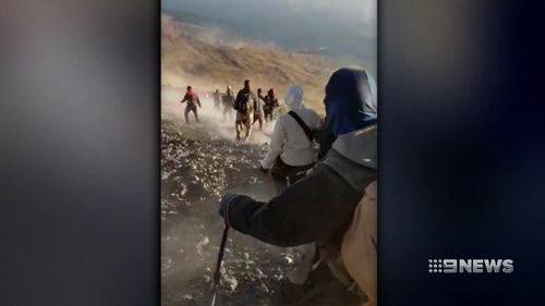 Around 500 trekkers are climbing down the slopes of Mount Rinjani on Indonesia's Lombok island. Picture: 9NEWS