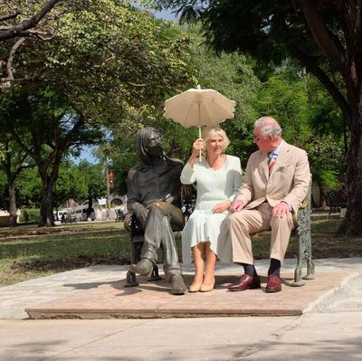 Charles and Camilla with John Lennon's statue, March 2019