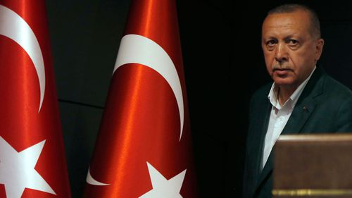 Turkish President Recep Tayyip Erdogan arrives for a press conference after the local election.