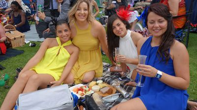Friends have a picnic on the lawn. (ninemsn)