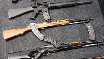Police seized a Colt AR 15 .223 assault rifle; two SKS .762 assault rifles; a sawn-off .22 Ruger rifle and suppressor; a Bentley 12-gauge shotgun.