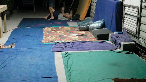Beds on the floor of a makeship camp at the former Manus Island centre. (Asylum Seeker Resource Centre)