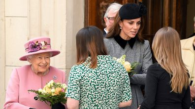 The royal duo are greeted by officials at the college.