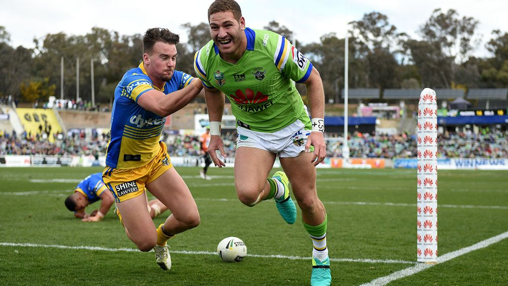 Raiders winger Brenko Lee celebrates after scoring one of four tries against the Eels.
