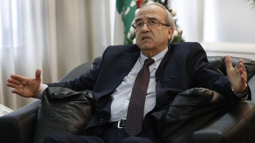 Lebanese Justice Minister Albert Serhan, speaks during an interview with the Associated Press, in Beirut, Lebanon, Thursday, Jan. 2, 2020. Serhan says Lebanon has received an international wanted notice from Interpol for Nissan's ex-chair Carlos Ghosn