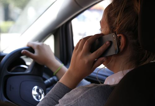 Drivers who talk on their phones are twice as likely to be involved in an accident. Picture: AAP