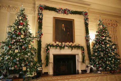 In the White House's State Dining Room, excessive decorations surround a portrait of Abraham Lincoln. (Alex Wong/Getty)