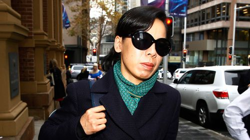 Kathy Lin, wife of accused murderer Robert Xie leaves the Sydney Supreme Court after giving evidence. (AAP)